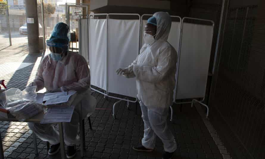 Two healthcare workers dressed in PPE.
