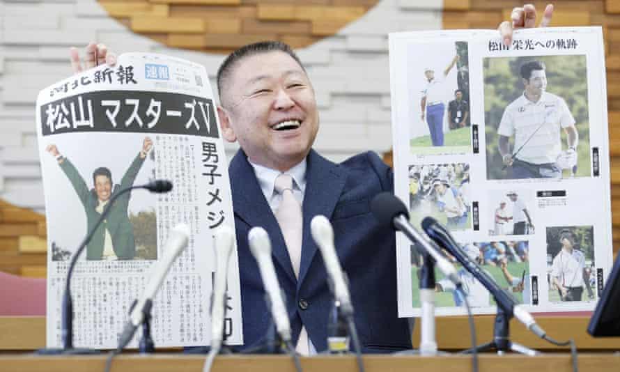 Yasuhiko Abe, who coached golfer Hideki Matsuyama during his Tohoku Fukushi University years, holds special editions of newspapers featuring Matsuyama's Masters victory