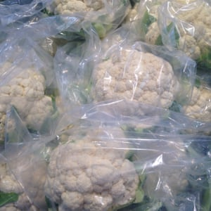 Where's the cauliflower?A local fruit market in Brisbane is required to bag their leafy vegetables according to the shopping centre management policy
