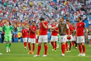 As the players salute the fans, Harry Maguire looks forlorn.