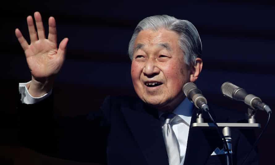 Akihito waves to well-wishers