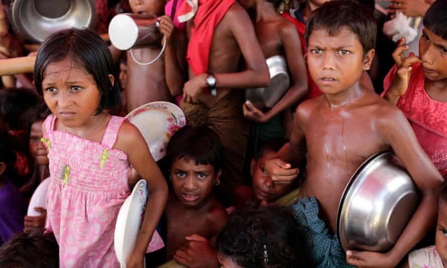 Rohingya children queue to collect food in a refugee camp in Ukhiya, Cox's Bazar, Bangladesh. the World Food Programme has withdrawn a critical report on hunger in Myanmar at the request of the government.