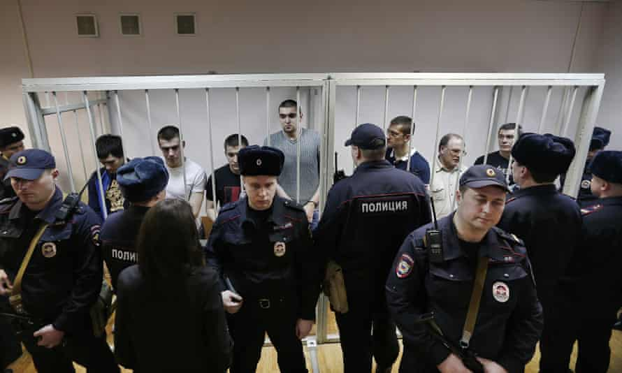 Protesters seen behind bars at the Moscow Zamoskvoretsky Court, February 2014.