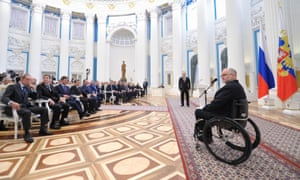 Sir Philip Craven, president of the International Paralympic Committee, speaks as Vladimir Putin listens to him during an awards ceremony in the Kremlin