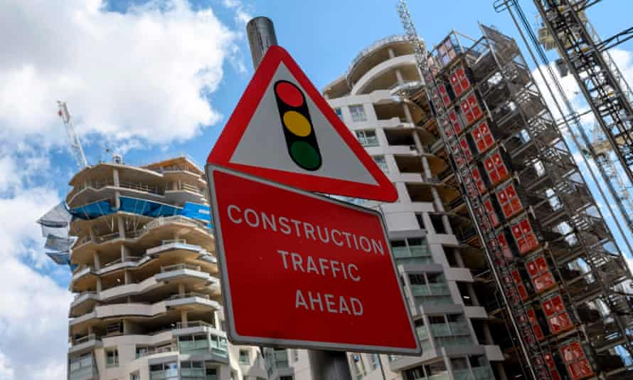 A construction sign at the Battersea Power Station redevelopment site, south London, August 2020.