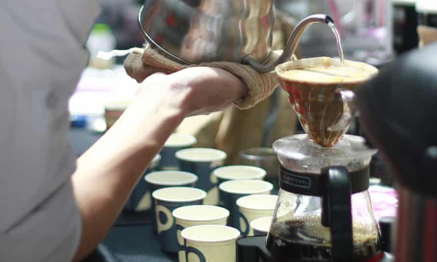 A barista preparing coffee using the V60 in Kuala Lumpur.