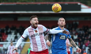 Stevenage's Jack King and Notts County's Lewis Alessandra challenge for the ball.