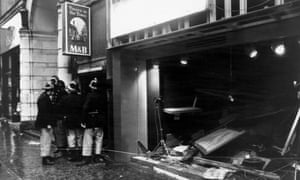 Firefighters survey the damage outside the Tavern in the Town pub in Birmingham after an IRA bomb blast, in November 1974.