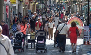 People walk without wearing face masks in Gibraltar.