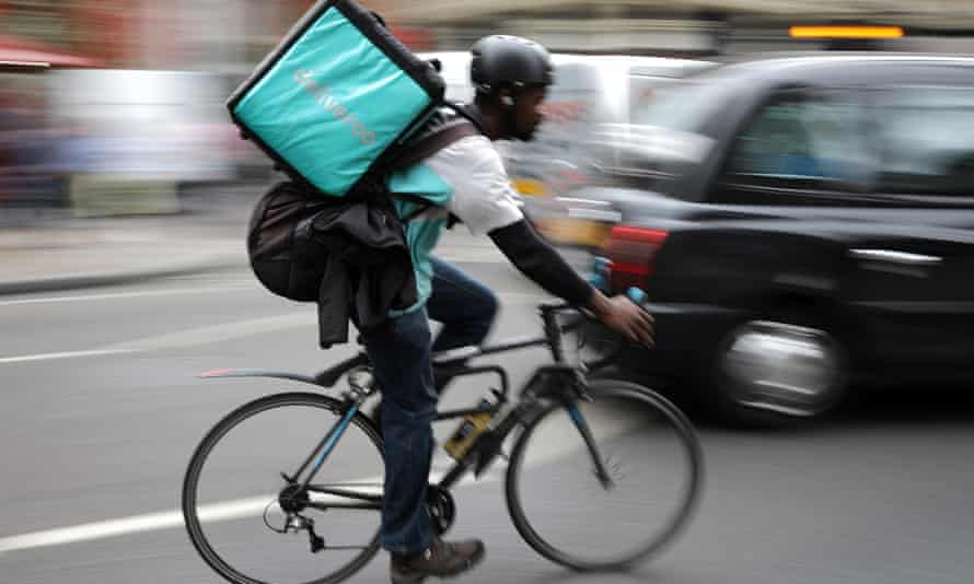 A Deliveroo rider on a bicycle.