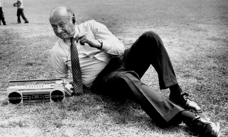 Ed Koch listens to music in Central Park.