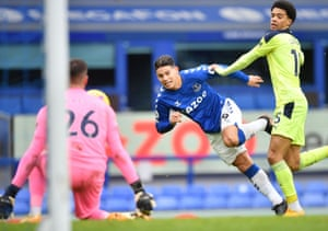 Everton's James Rodriguez gets past Newcastle United's Jamal Lewis but can't direct his shot past Newcastle keeper Karl Darlow.