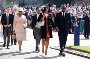 Idris Elba and Sabrina Dhowre, followed by Oprah Winfrey at the chapel