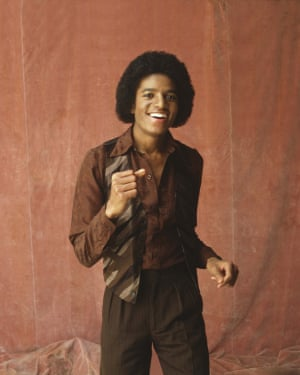 A young Michael Jackson in 1979: His all-brown outfit is straight from an era when car keys got put in bowls and cheese and pineapple got put on cocktail sticks. Although it's been a firm Prada favourite through the years, being a notoriously tricky colour to wear, brown has often been out of fashion's favour. The all-brown 70s suit featured on Gucci's catwalk for spring/summer 2017, but not all mono-toning is murky. For spring/summer 2019, Versace's models wore lurid all-pink and fluoro highlighter-yellow suits.