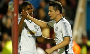 Ander Herrera celebrates scoring their second goal with Marcus Rashford.