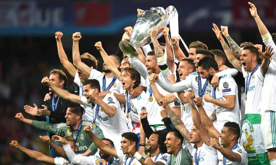 Real Madrid celebrate after winning the 2018 Champions League final against Liverpool, completing a hat-trick of triumphs.