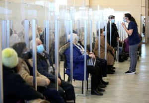 Seniors sit in a waiting room after receiving their vaccine against coronavirus in a clinic as Quebec begins vaccinations for seniors over 85 years old in Laval, Quebec, Canada, on 25 February, 2021.