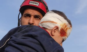 Abdullah rescuing a child from the rubble.