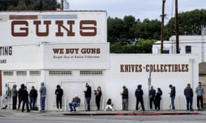 People wait in a line to enter a gun store in Culver City, California Sunday.