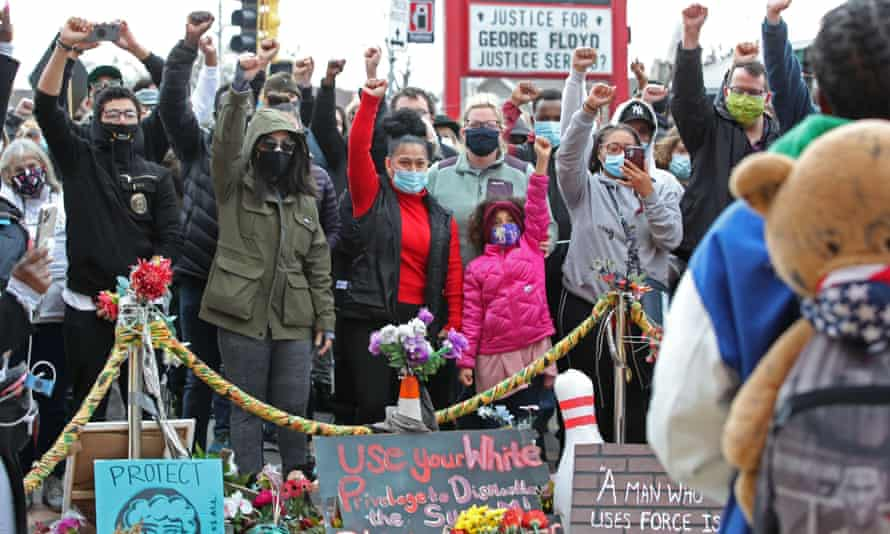 People react to the guilty verdict at a memorial erected at the site of George Floyd's death.