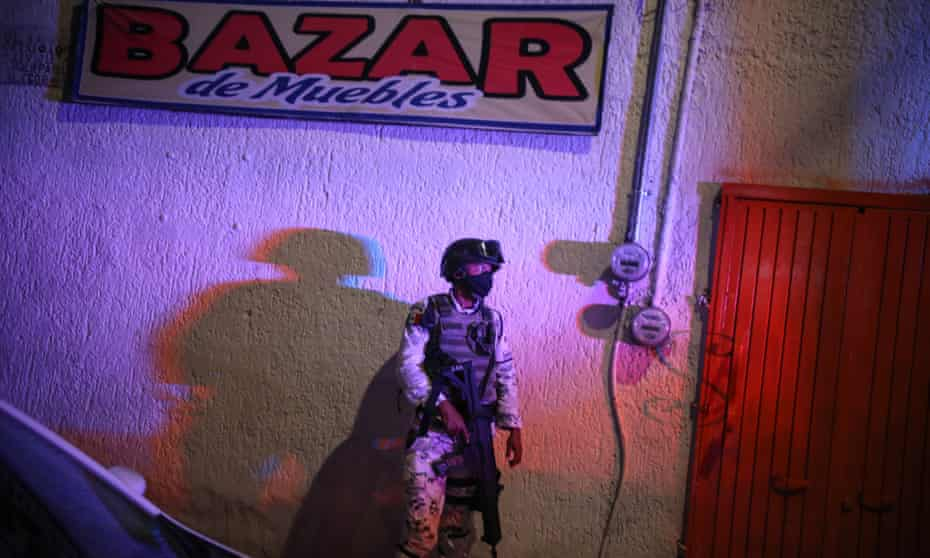 A soldier guards a crime scene in Guadalajara, September 2020.