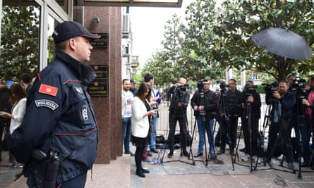 Media gather in front of the high court in Podgorica