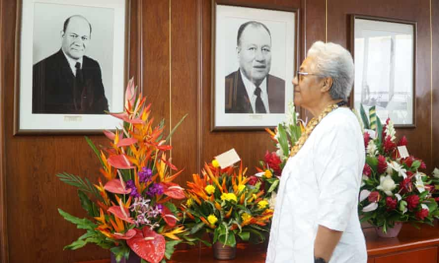 Fiame Naomi Mata'afa looks at the images of former prime ministers on the wall of her office, including that of her late father, the country's first PM.