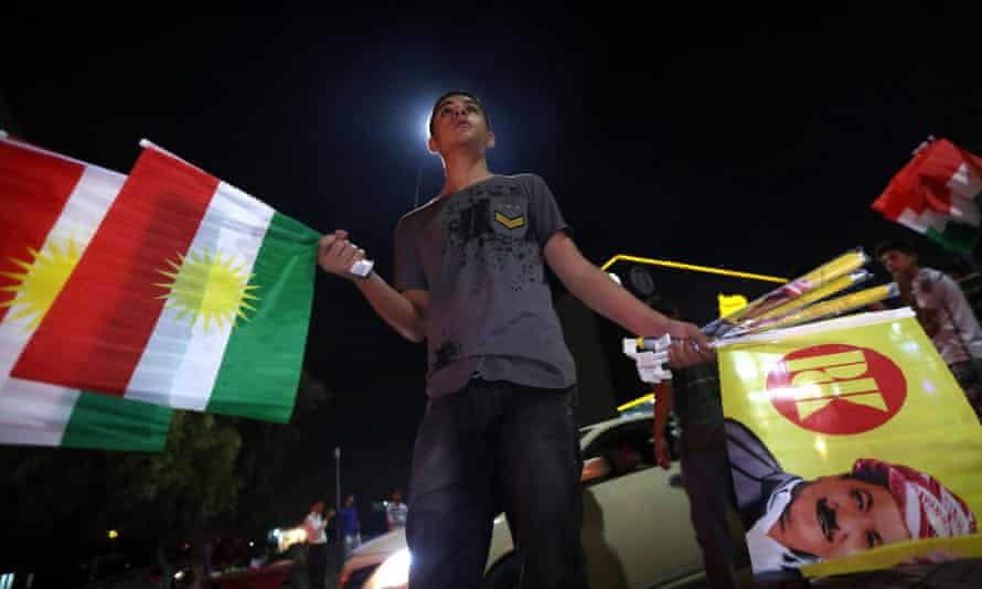 Iraqi Kurds celebrate the results of the independence referendum in Erbil.