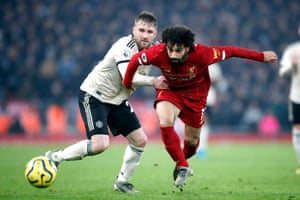 Liverpool's Mohamed Salah (right) and Manchester United's Luke Shaw fight for the ball.