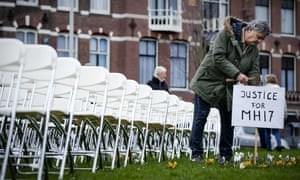 Relatives of victims of the MH17 crash hold a silent protest in front of the Russian embassy in The Hague