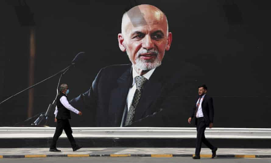 A mural of Ashraf Ghani hanging at Hamid Karzai international airport