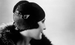 A pleated black satin hat by designer Eliane Mary, circa 1935.