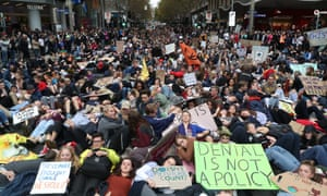 Protesters are seen lying down on Swanston Street in solidarity with the global climate strike in Melbourne on Friday.