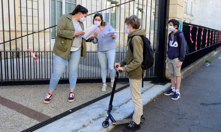 Supervisors speak to students before they restart school in Bordeaux as pupils returned to secondary school in 'green' areas of the country