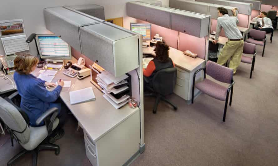 Business people in office cubicles.