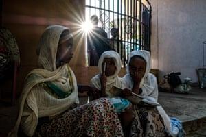 Ethiopian Orthodox girls play outside St George church in Bahir Dar, Ethiopia
