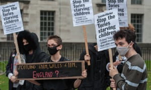 Protesters against the government decision not to extend free school meals during half term and the Christmas holidays outside Downing Street on Saturday.