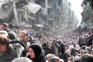 Crowds of refugees fleeing a ruined city