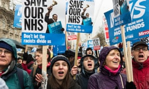 Protesters march at a rally for the NHS in London