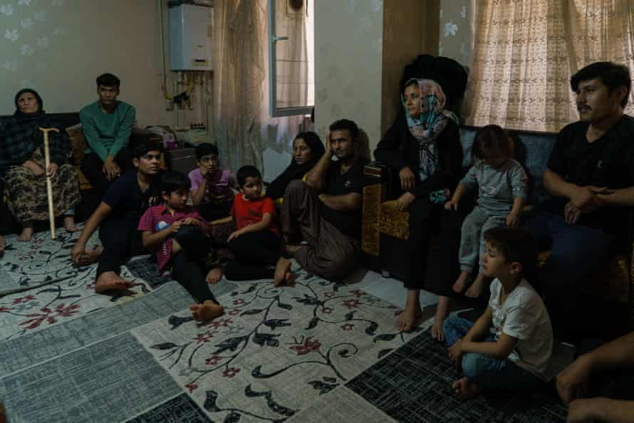 Afghans wait in the smuggler's safe house in Van before being moved to other cities in Turkey