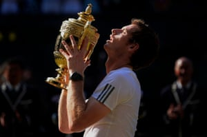 Andy Murray lifts the trophy after the mens singles final against Novak Djokovic on Centre Court during Wimbledon 2013 day thirteen in July 2013.
