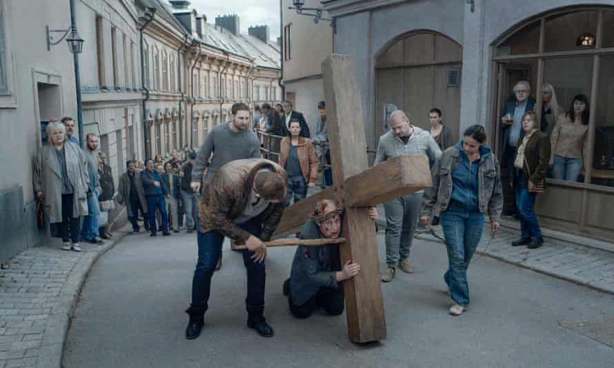 Crisis of faith … a priest dreams he is carrying a cross through the streets of Stockholm