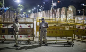 Police in New Delhi seal off a street