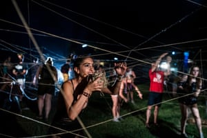 Northern Budapest, Hungary: Participants during a performance entitled It's Not That Way, It's This Way by the South Korean-French group Galmae at the Sziget festival