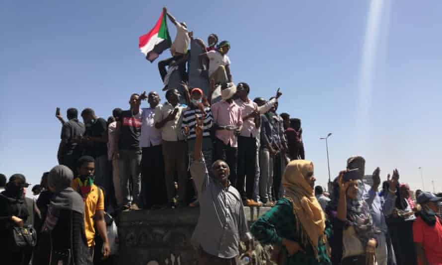 Demonstrators chant slogans in Khartoum.