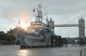 Guns are fired onboard HMS Belfast in London