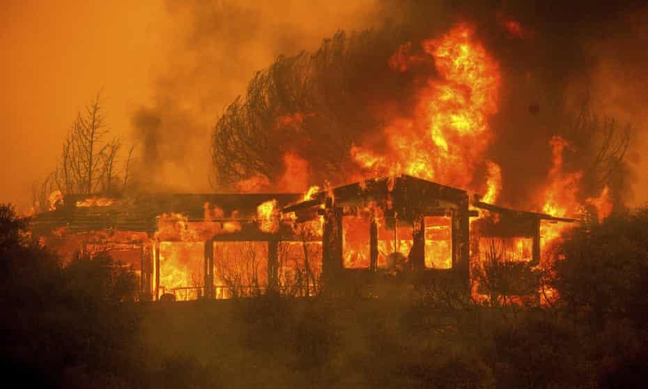 A home burns near Finley, California, on 30 July.