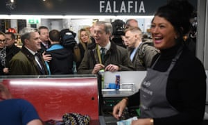 The Brexit party leader Nigel Farage touring an indoor market in Hull today.