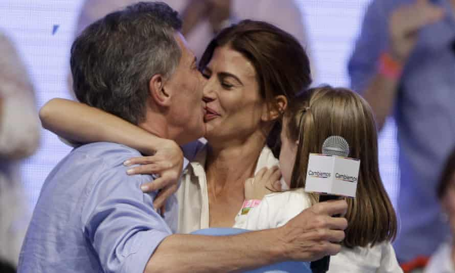 Mauricio Macri, left, kisses his wife Juliana Awada after winning a runoff presidential election in Buenos Aires, Argentina on Sunday.
