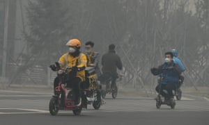 People wearing face masks ride motorcycles in smog on 15 April, 2020 in Changchun, Jilin Province of China.